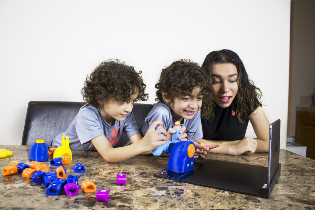 twins-and-mom-playing-with-toys