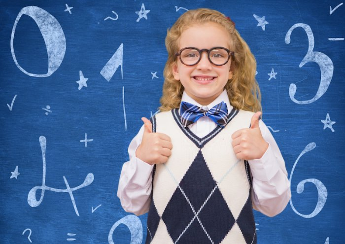 Digital composition of smiling girl showing thumbs up against mathematical background